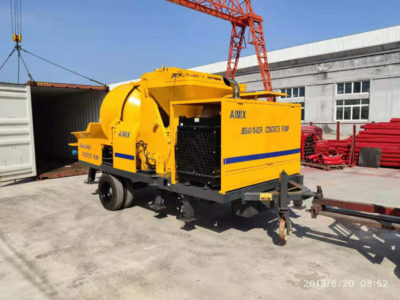 loading concrete mixer and pump