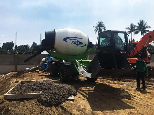 Small Concrete Mixer Working on Construction Site