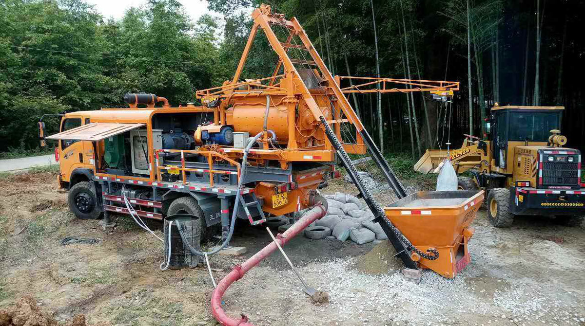 Truck Mounted Concrete Mixer Pump Working on Construction Site